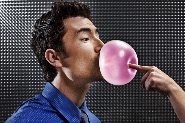 Businessman having bubble popped --- Image by © Tim Tadder/Corbis