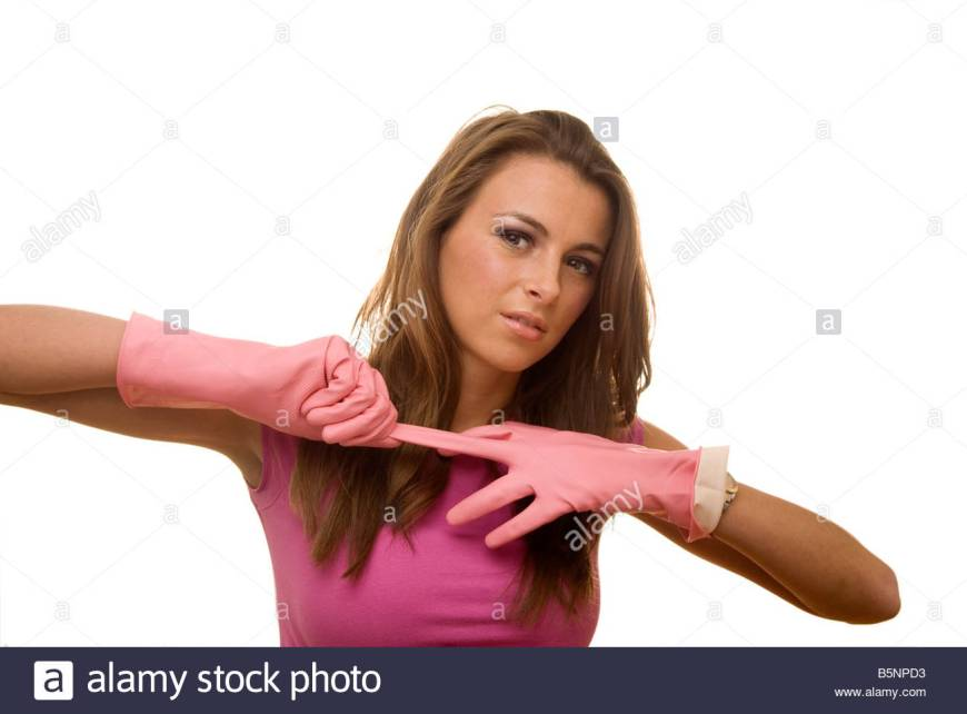 woman-pulling-off-a-pair-of-rubber-gloves-b5npd3